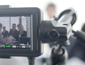 Videographer recording a deposition
