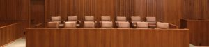 paused jury trial system resists restart plans during COVID